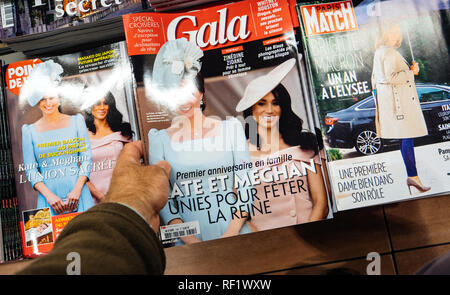 PARIS, FRANCE - CIRCA 2018 POV hand newspaper kiosk stand with Gala magazine showing Meghan Markle and Catherine Kate Middleton, Duchess of Cambridge  - Stock Photo