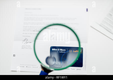 FRANKFURT, GERMANY - JAN 14, 2015: Miles and More card point card received by post from German Lufthansa airlines - inspection with the magnifying glass loupe - Stock Photo