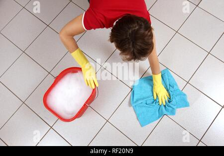House work, woman cleaning, wiping floor with damp cloth - Stock Photo