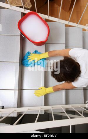 House work, woman cleaning, wiping stairs in a flat - Stock Photo