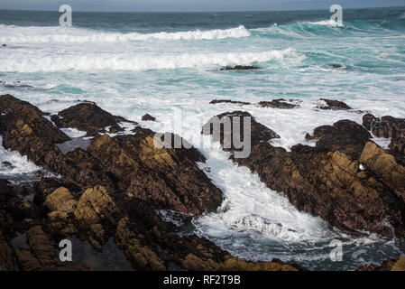 Rocky shore line, waves and beach scene on the Monterrey Peninsula.  The variation and variety of beautiful seascapes are endless. - Stock Photo