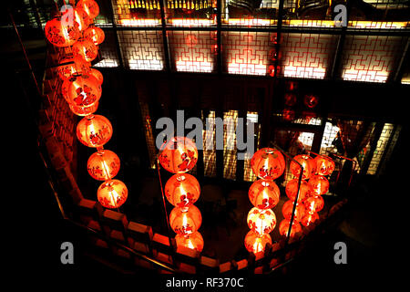 Hong Kong, China. 23rd Jan, 2019. Red lanterns are displayed on a street to greet the Spring Festival in Hong Kong, south China, Jan. 23, 2019. The Spring Festival, or the Year of the Pig in the Chinese lunar calendar, will begin on Feb. 5 this year. Credit: Wu Xiaochu/Xinhua/Alamy Live News - Stock Photo