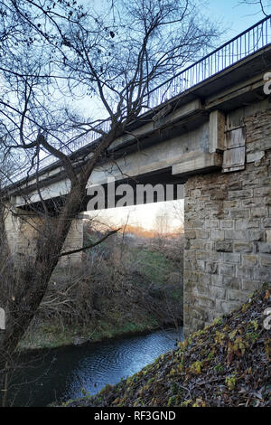old stone bridge over a shallow river 2019 - Stock Photo
