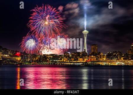 Lake Union 4th of July Fireworks and the Seattle skyline, as seen from across Elliott Bay at Seacrest Park in West Seattle, WA, USA - Stock Photo