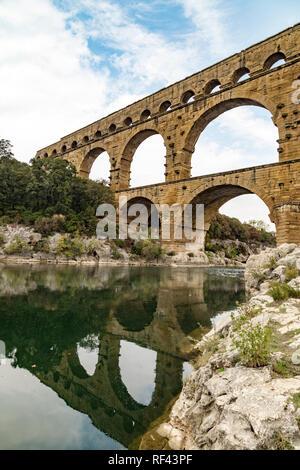 Ancient Roman aqueduct Pont du Gard in France - Stock Photo