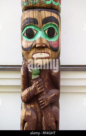 Detail of a traditional Northwest Coast Native American Tlingit Indian totem pole outside the Alaska State governor's mansion in Juneau, Alaska