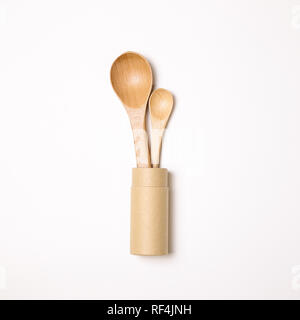Wooden spoons in holder on white background - Stock Photo