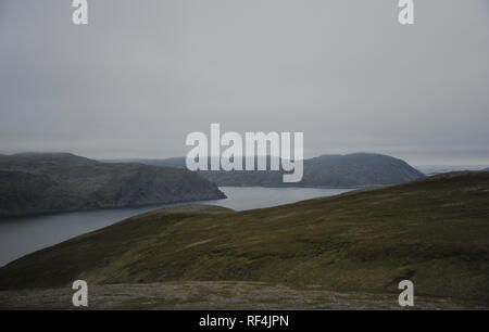 Landscape view of mountain and sea at Magerøya island in Finnmark county on the way to North Cape (Nordkapp) at midnight time in Norway - Stock Photo