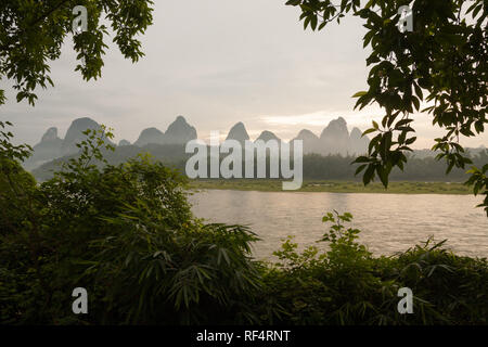 Sunrise over karst mountain and river Li in Yangshuo China - Stock Photo