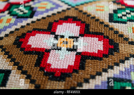 traditional patterns of Slavic embroidery (a colourful pillow case, second half of the 20th century, Slovakia) - Stock Photo