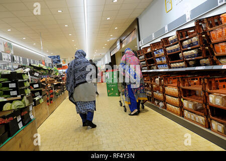 Lidl supermarket shoppers two elderly old women wearing headscarf shopping together in UK  KATHY DEWITT - Stock Photo