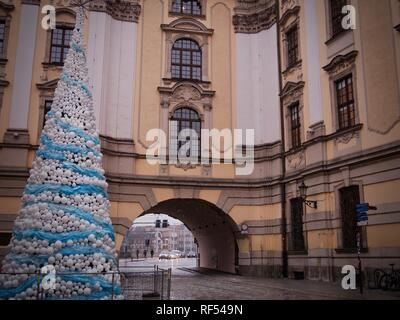 Baroque Architecture with a Christmas Tree and Light Snow in Wroclaw, Poland - Stock Photo