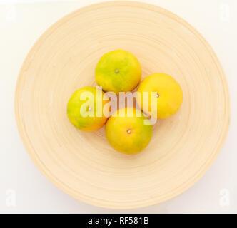 fresh ripe green and orange tangerine (citrus, mandarin) oranges, fruit on wood tray isolated on white table background. Seasonal Tropical Fruit, Natu - Stock Photo