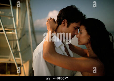 Portrait of a young newlywed couple tenderly embracing after their wedding. - Stock Photo