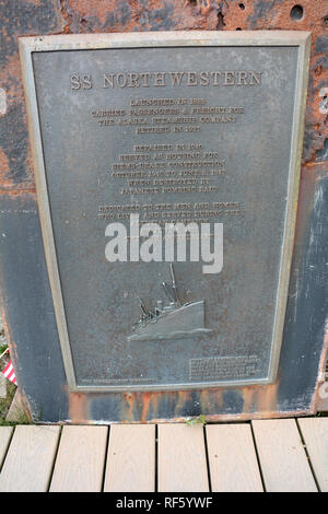 A plaque marking the sinking of the SS Northwestern, a US Navy ship that was bombed in World War Two in Dutch Harbor, Unalaska, Alaska, United States. - Stock Photo