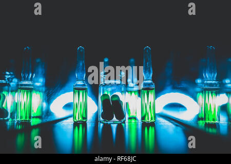 concept of doping in sport. Bright ampoules with luminous green contents: Diuretics, Peptide hormones, Anabolic steroids, Painkillers, Stimulants. art - Stock Photo