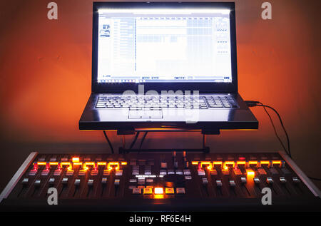 Modern mixing console and laptop on table, small home recording studio. - Stock Photo