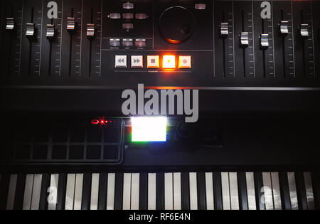 Modern mixing console and piano keys, small home recording studio. - Stock Photo
