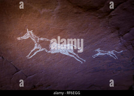 Algeria, Wilaya Tamanrasset, Hoggar Mountains, ancient rock drawings of animals in the Sahara desert - Stock Photo