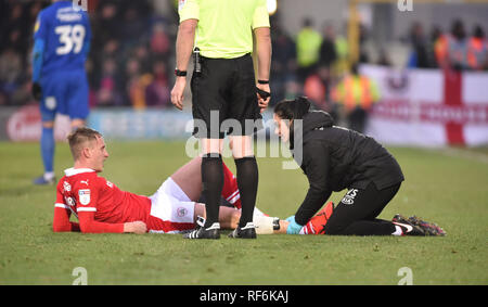 Cauley Woodrow of Barnsley is treated by the physiotherapist during the League One match between  AFC Wimbledon and Barnsley at the Cherry Red Records Stadium . 19 January 2019  Editorial use only. No merchandising. For Football images FA and Premier League restrictions apply inc. no internet/mobile usage without FAPL license - for details contact Football Dataco - Stock Photo