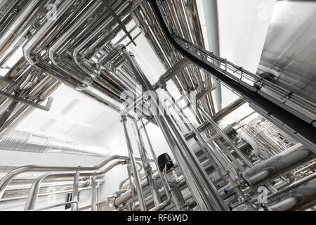 Aluminum pipes and equipment in production of fresh cheese concept - Stock Photo