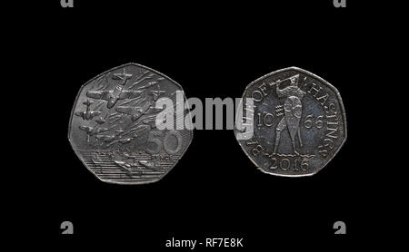 UK commemorative 50 pence coins celebrating the two invasions that are part of UK history. - Stock Photo