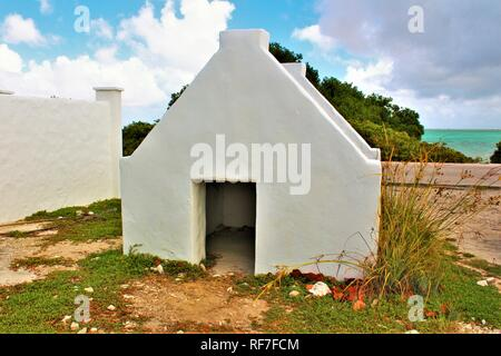 The front of one of the former slave huts on the Caribbean island of Bonaire. These were built in 1850 to house slaves that worked on the salt mines. - Stock Photo