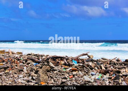 Rubbish washed ashore on the island of Bonaire, from the polluted Caribbean ocean. Plastic pollution in the oceans is a growing worldwide problem. - Stock Photo