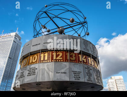 The World Clock or Urania Clock is large turret-style world clock at Alexanderplatz Mitte, Berlin.  It shows the current time of 148 world cities - Stock Photo
