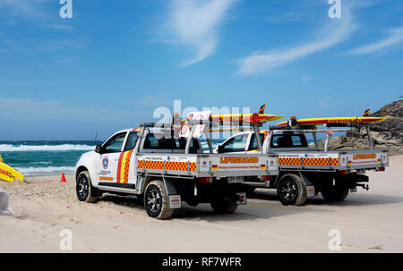 Lifeguard vehicles on Cylinder Beach, Point Lookout, North Stradbroke Island, Queensland, Australia - Stock Photo