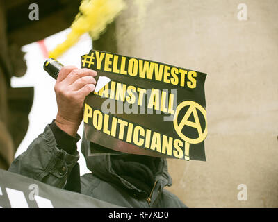Angry group of anti-government anarchists demonstrators with banners, protesting against the state of the Brexit deal, at Portland Place, London, UK. - Stock Photo