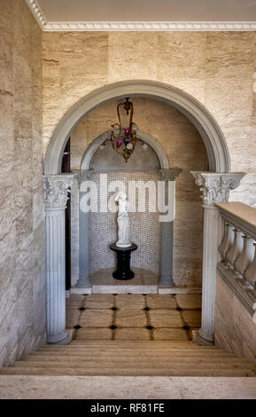 Venus statue on a pedestal at an Italian home. - Stock Photo