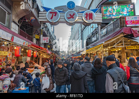 Ameyoko or Ameyayokocho market near Ueno station. One of main shopping street in Tokyo. Text advertise market name and vendor shops including watches - Stock Photo