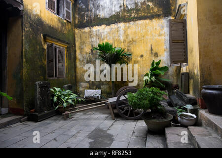 An old inner courtyard in one of the structures in Ancient Town in Hoi An, Vietnam. - Stock Photo