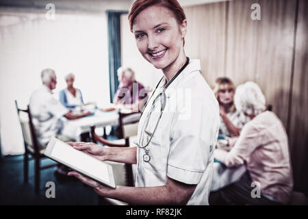 Portrait of a nurse with digital tablet - Stock Photo