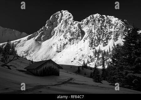 Mountain hut in front of the snow-covered summit of the Gehrenspitze, Reutte, Außerfern, Tyrol, Austria - Stock Photo