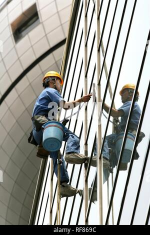 Window cleaner, glass facade of a skyscraper, Tokyo, Japan, Asia - Stock Photo