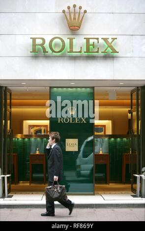 Ginza elegant shopping and entertainments district Rolex store on Chuo Dori Street Tokyo Japan - Stock Photo
