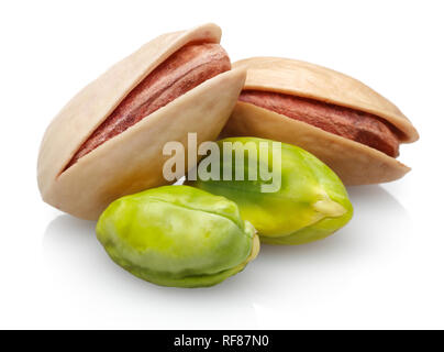 Peeled and whole pistachio nuts isolated on white background - Stock Photo