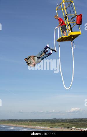Bungee jumping from the pier, Scheveningen, The Hague, The Netherlands, Europe - Stock Photo