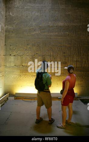 Tourists at the Temple of Edfu (dedicated to the falcon god Horus), Edfu, Egypt, Africa Stock Photo