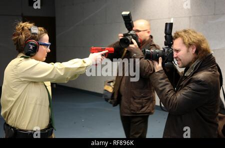 Police officer posing for photographers during a press conference at a new police shooting range, Duesseldorf - Stock Photo