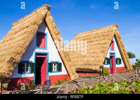 Santana Madeira Palheiro house Traditional triangular A-framed Palheiro Houses Santana Madeira Portugal red blue and white painted house portuguese - Stock Photo