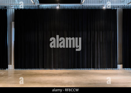 Black movie theater curtains with concrete floors. Empty spare for performance - Stock Photo