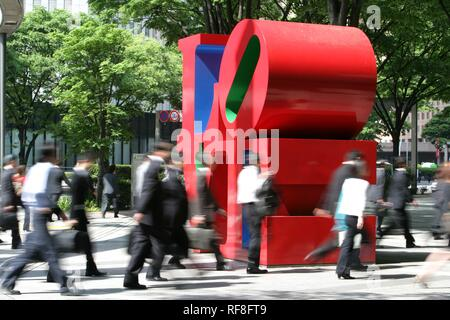 People on their way to work walking by Love-sculpture by American artist Robert Indiana, Shinjuku district, Tokyo, Japan, Asia - Stock Photo