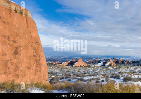 Winter is a great time to visit Arches National Park in Utah, when the park is less crowded and there is a chance snow will blanket the landscape - Stock Photo