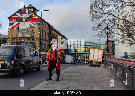 London, UK - 20, December 2018: Man in 18th century British army infantry redcoat uniform walking in Camden Town, UK - Stock Photo