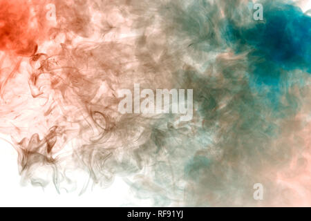 Gray smoke on a white background is highlighted in red and blue with thin jets welded into smooth lines evaporating from the vape. - Stock Photo