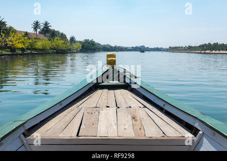 Bow of a wooden tourist passenger ferry on the Thu Bon River in Hoi An, Vietnam - Stock Photo