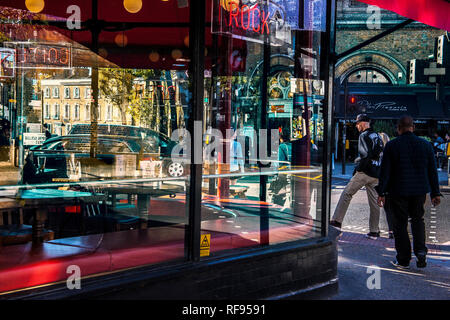 colourfull/colorfull street life  reflected in buildings windows - Stock Photo